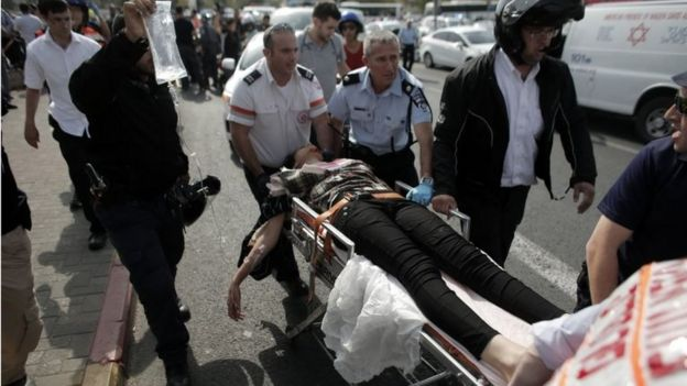 Injured suspected attacker wheeled away by Israeli medics in Jerusalem (12/10/15)