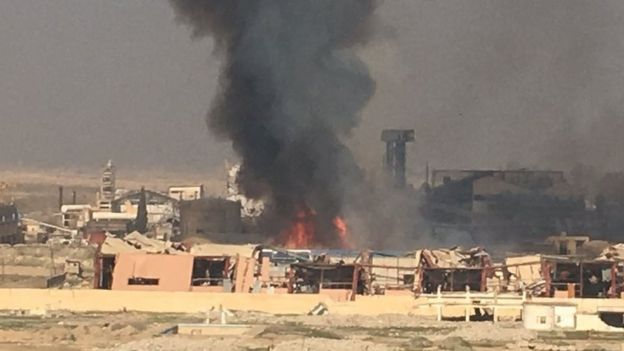 A sugar factory near the airport that had been held by IS is in flames