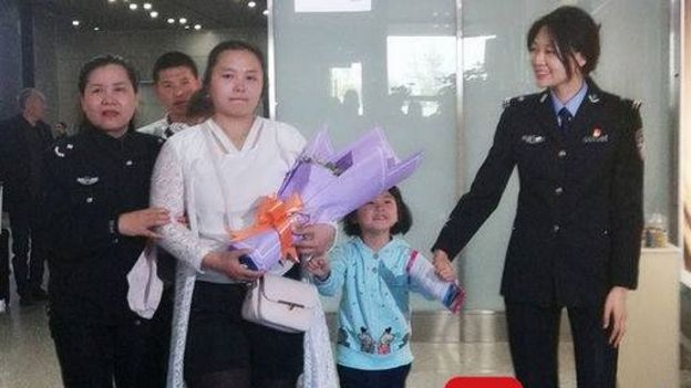 Kang Ying and her family at the airport