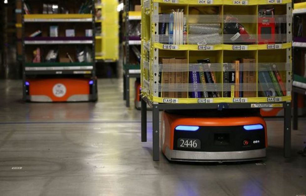 Kiva robots move racks of merchandise around an Amazon warehouse