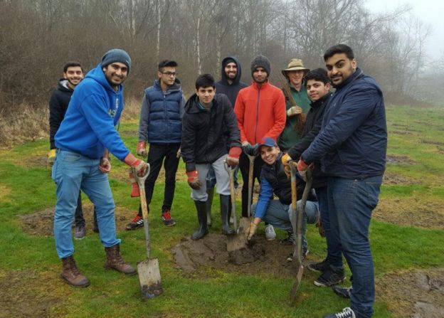 Members of The Ahmadiyya Muslim Youth Association planting trees