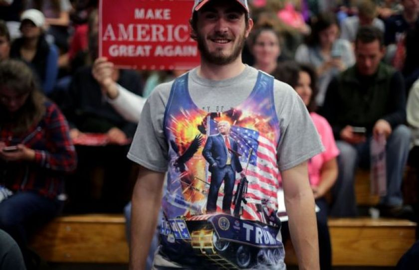 A man wears a tank top depicting Republican presidential nominee Donald Trump standing on a tank during a campaign rally for Trump at the W.L. Zorn Arena November 1, 2016 in Eau Claire, Wisconsin.