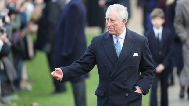 Prince Charles speaks to the crowds outside the church