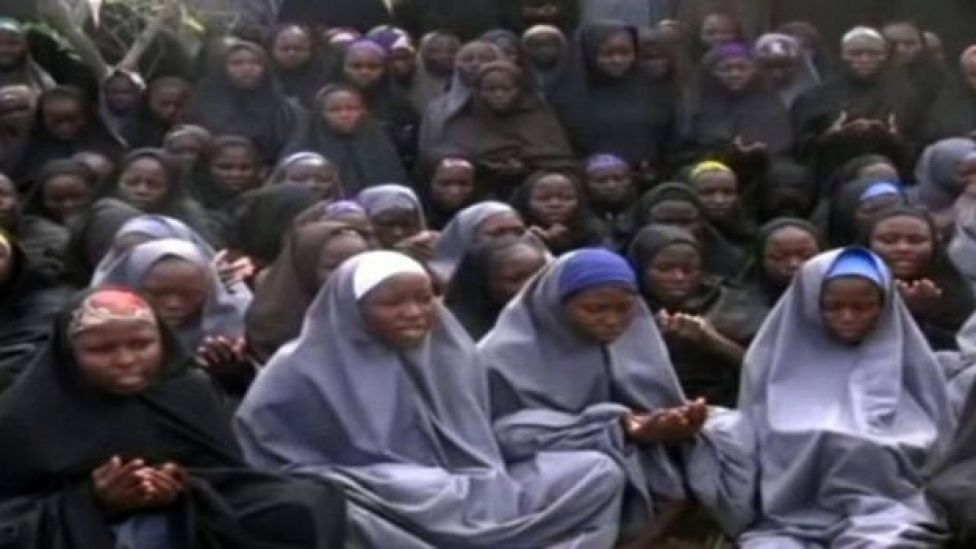 This file photo taken on May 12, 2014 shows a screengrab taken from a video of Nigerian Islamist extremist group Boko Haram obtained by AFP showing girls, wearing the full-length hijab and praying in an undisclosed rural location.