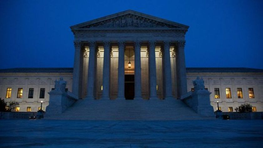 The US Supreme Court at night.