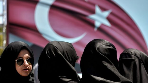 Women attend a demonstration in support of Turkish President Recep Tayyip Erdogan