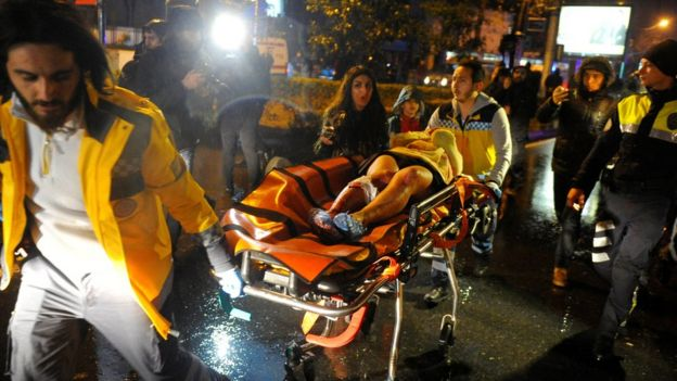 An injured woman is taken to an ambulance in Istanbul