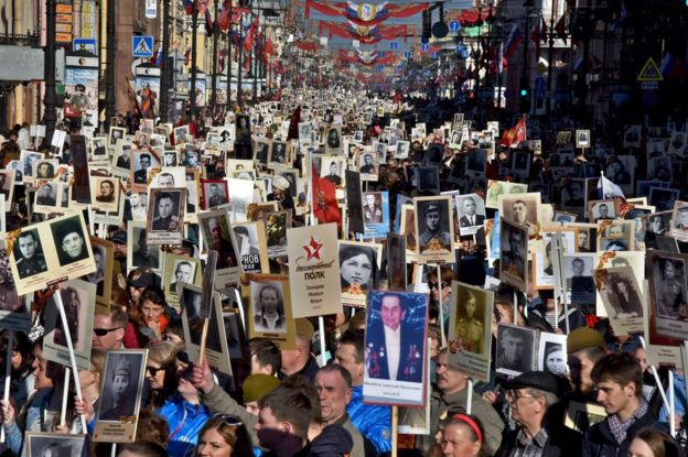 People carry portraits of WW2 soldiers in the Immortal Regiment march in St Petersburg