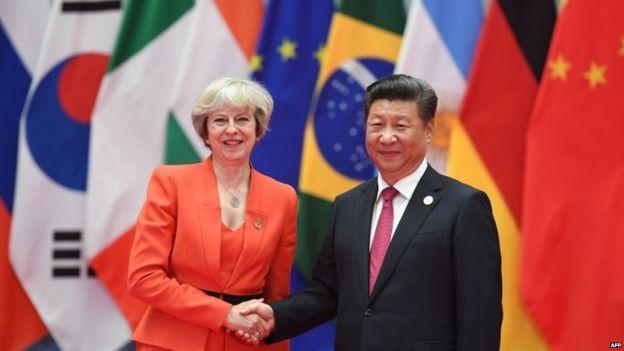Theresa May and Chinese premier Xi Jinping