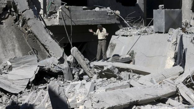 The aftermath of what activists said was barrel bombs dropped by forces loyal to Syria's President Bashar Al-Assad