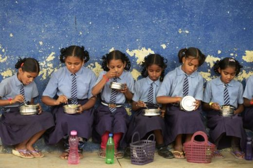 Indian school girls eating lunch