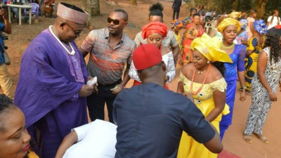 A family member felicitate with the couple