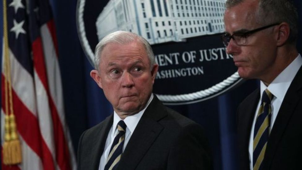 Jeff Sessions (left) looks at Andrew McCabe during a July 2017 news conference