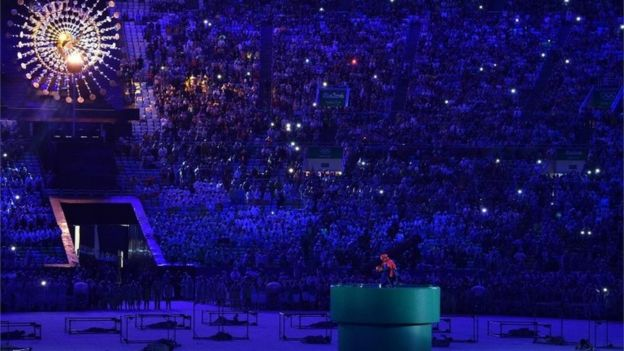 Japanese Prime Minister Shinzo Abe, dressed as Super Mario, holds a red ball during the closing ceremony of the Rio 2016 Olympic Games at the Maracana stadium in Rio de Janeiro on August 21, 2016. / AFP PHOTO / LUIS ACOSTALUIS ACOSTA/AFP/Getty Images