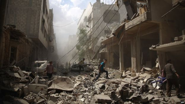 The aftermath of Syrian government airstrikes near Damascus in August