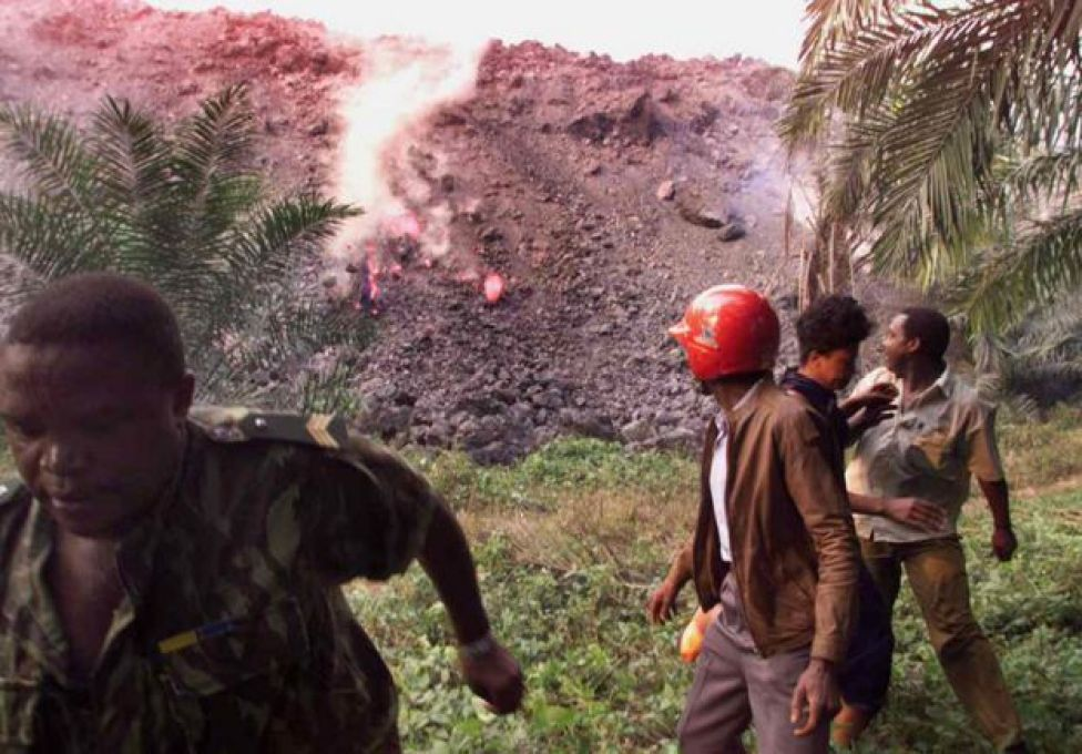 People flee a river of molten lava during Mount Cameroon's 1999 eruption