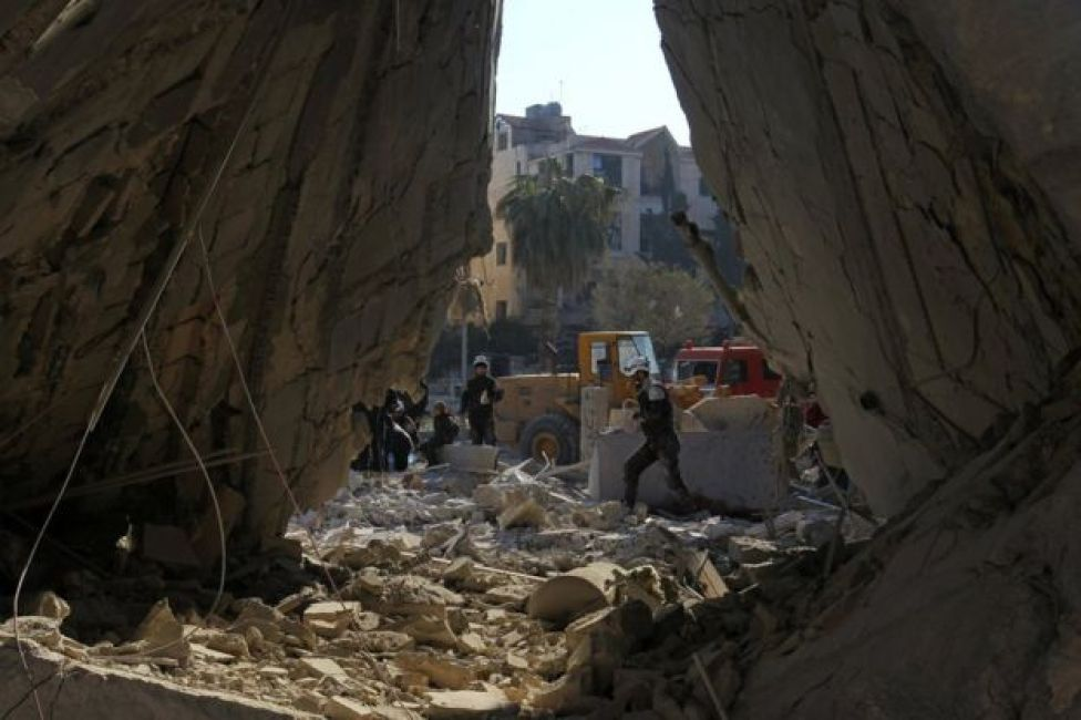 Syrian rescue workers search for survivors after air strikes in rebel-held city of Idlib on 7 February 2017