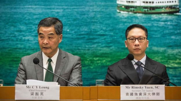 Hong Kong Chief Executive Leung Chun-ying (L) and Secretary for Justice Rimsky Yuen (R) take part in a press conference in Hong Kong on November 7, 2016