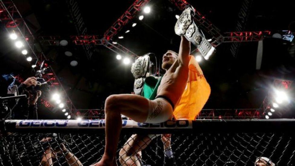Conor McGregor celebrating his UFC lightweight championship victory over Eddie Alvarez in November 2016.
