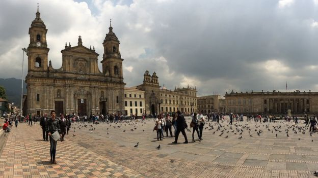 People and birds stroll in Bogota, Colombia