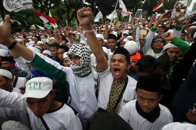 Indonesian muslim shout slogans during an anti Governor Basuki Tjahaja Purnama, better known by his nickname