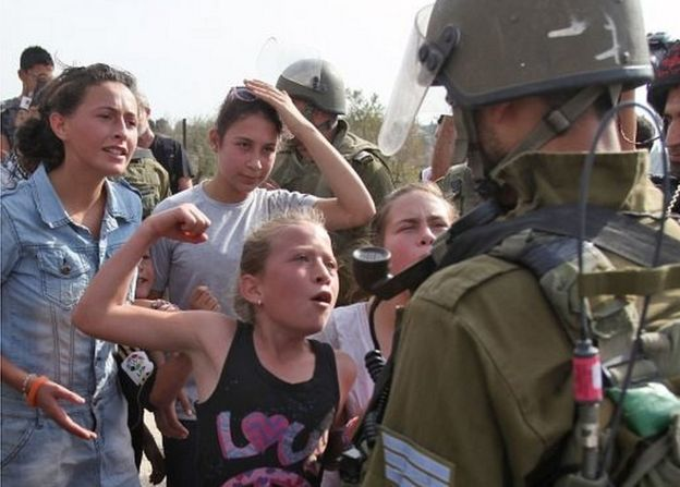 Ahed Tamimi gesturing as if to punch an Israeli soldier (02/11/12)