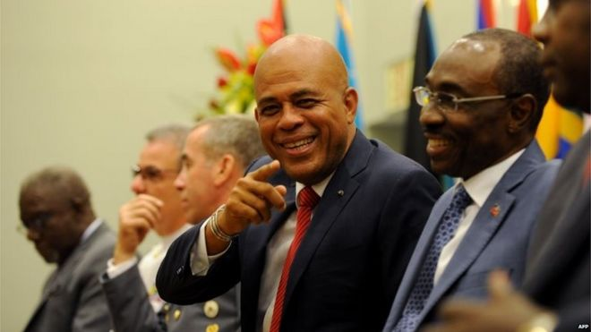 Michel Martelly smiles as he attends a ceremony in Petion Ville on 25 June, 2015.