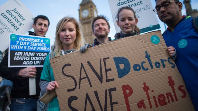Junior doctors and medical students demonstrate outside the Houses of Parliament in London as part of an England-wide one-day strike in a dispute with the government over new contracts