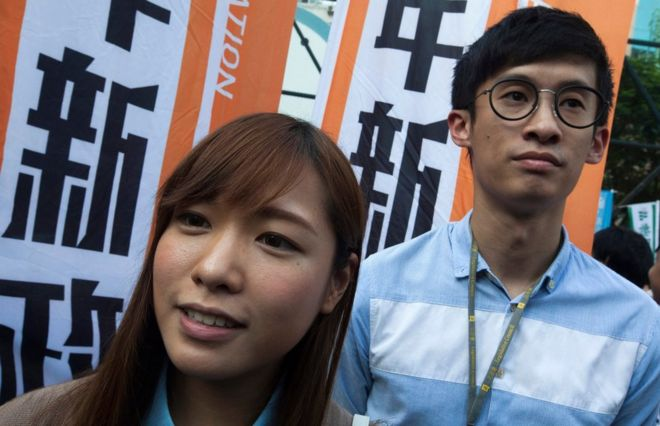 Legislative Councillors-elect Yau Wai-ching (L) and Sixtus Leung (R) are seen as thousands of people march through the streets of Hong Kong to protest against the Legislative Council oath-taking interpretation of the city's Basic Law, or mini-constitution, by the Chinese authorities in Beijing, Hong Kong, China, 6 November 2016