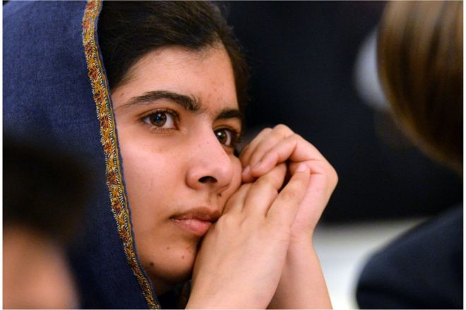 Pakistani activist for female education and Nobel Peace Prize laureate Malala Yousafzai listens to speakers at an event to commemorate the Peshawar school massacre in Birmingham, north England on 14 December 2015