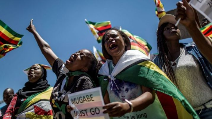 "This file photo taken on November 18, 2017 shows supporters of Tajamuka Sesijikisile SA, The African Democrats Opposition Party, the Zimbabwe Communist Party, the Zimbabwe Diaspora Coalition and other groups attending a rally at the Union Buildings in Pretoria, South Africa, to call for the resignation of Zimbabwe""s President."