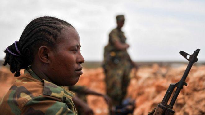 Ethiopian solider holds a gun in Somalia