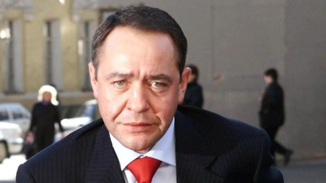 "Russia""s Mass Media Minister Mikhail Lesin enters his ministry in central Moscow, in this file photo from March 27, 2002"