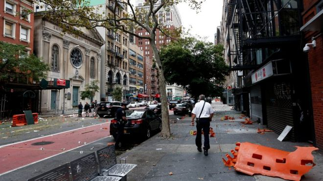 """Police investigate at the site of an explosion that occurred on Saturday night on September 18, 2016 in the Chelsea neighborhood of New York City. An explosion in a construction dumpster that injured 29 people is being labeled an """"intentional act"""". A second device, a pressure cooker, was found four blocks away that an early investigation found was likely also a bomb."""