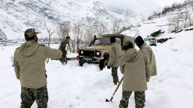 Rescue workers trying to reach the avalanche-hit areas in Chitral, Pakistan