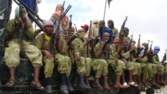 In this 30 October 2009 file photo, al-Shabab fighters sit on a truck as they patrol in Mogadishu, Somalia
