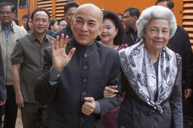Cambodia's King Norodom Sihamoni and his mother, former queen Monique, at the railway station in Phnom Penh on December 30, 2016.