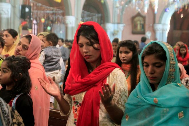 People attend a mass on Christmas day at the Cathedral Church in Lahore, Pakistan December 25, 2017