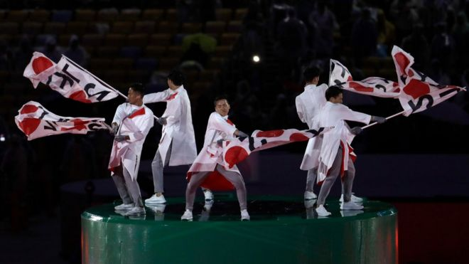 Dancers perform with Japanese flags during the closing ceremony in the Maracana stadium at the 2016 Summer Olympics in Rio de Janeiro, Brazil, Sunday, Aug. 21, 2016
