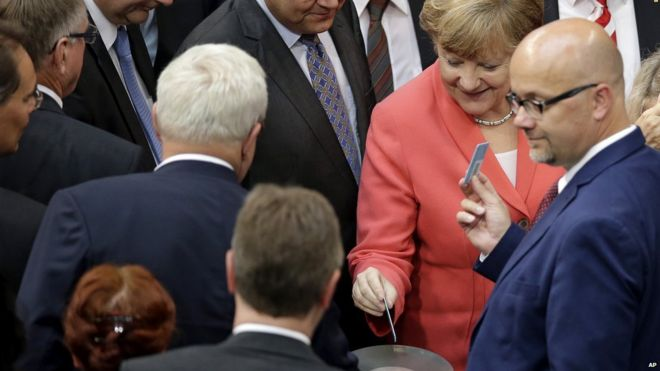 German Chancellor Angela Merkel votes in parliament. 17 July 2015