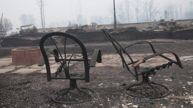 Home foundations and skeletons of possessions are all that remain in parts of a residential neighborhood destroyed by the wildfire (07 May 2016)