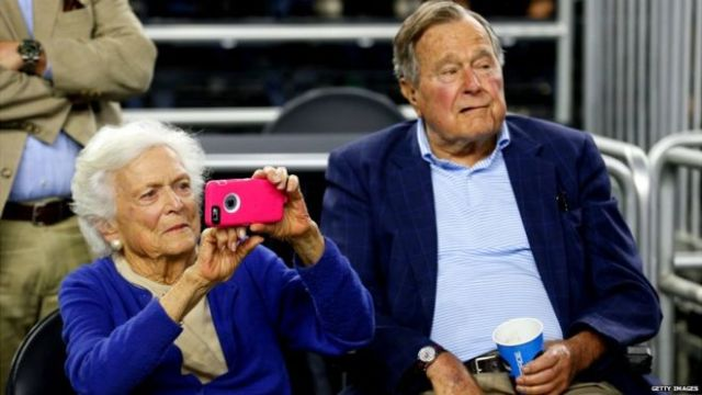 Former President George HW Bush and his wife Barbara Bush watch the 2015 NCAA Men's Basketball Tournament in Houston, Texas - March 29, 2015