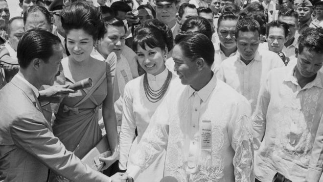 President Ferdinand Marcos (r) and his wife Imelda (second from left), greet South Vietnamese Premier Nguyen Cao Ky (l) and his wife (second from right) in Manila as they arrive for a state visit on August 10, 1966.