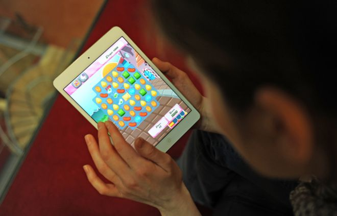 Image result for image of a teenage girl playing candy crush
