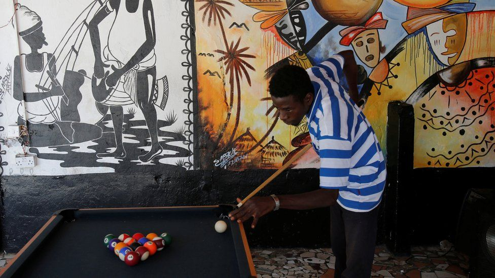 A man playing pool in Bakau, The Gambia - Monday 20 February 2017