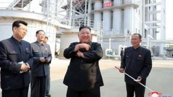 "Kim Jong-un Dancing 'shaku-shaku' style: ""Thunderous cheers of 'hurrah'"" were heard as the factory was opened, according to KCNA 1 May 2020"
