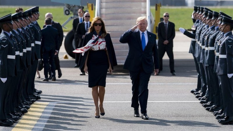 S President Donald J. Trump (R) salutes and First Lady Melania Trump (L) as they arrive at London Stansted Airport in Essex, Britain,