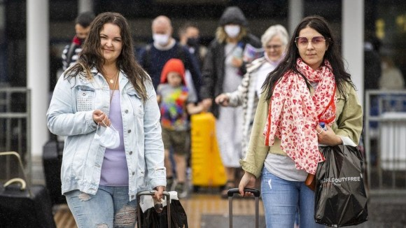 Passengers leaving Belfast International Airport on Monday after arriving on a flight from Barcelona