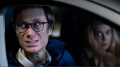 Greg (Stephen Merchant) and Rosie (Chloe Partridge) in a car