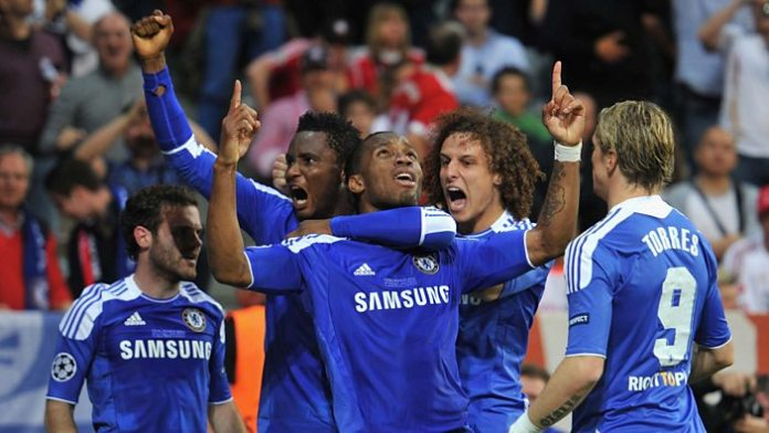 Drogba is mobbed after equalising in the 2012 Champions League final